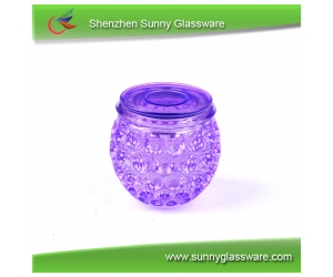Glass candle container with color spraying